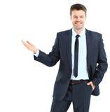 Uomo felice di affari che presenta e che mostra con lo spazio della copia per il yo Immagini Stock