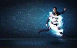 Uomo felice di affari che salta con la nuvola di tempesta intorno lui Fotografie Stock Libere da Diritti