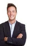 Uomo felice di affari con le braccia Immagine Stock