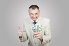 Uomo felice di affari con soldi fotografie stock
