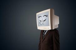 Uomo felice di affari con un monitor del computer e un fronte sorridente Immagini Stock Libere da Diritti