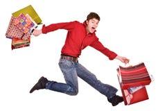 Uomo felice divertente allegro di acquisto. Fotografia Stock