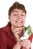 Uomo felice nel colore rosso con soldi. Fotografia Stock