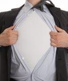 Uomo frustrato di affari che strappa fuori dalla sua camicia Fotografie Stock