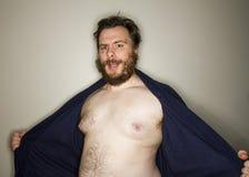 Uomo grasso che si rivela Fotografie Stock Libere da Diritti