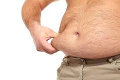 Uomo grasso con una grande pancia. Immagini Stock