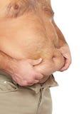 Uomo grasso con una grande pancia. Immagine Stock