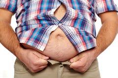 Uomo grasso con una grande pancia. Fotografia Stock Libera da Diritti