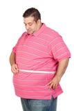 Uomo grasso con una misura di nastro Fotografie Stock Libere da Diritti