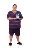 Uomo grasso con una sveglia blu Fotografie Stock