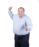 Uomo grasso felice in una camicia blu Immagine Stock
