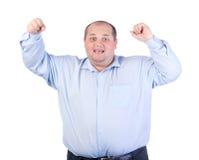 Uomo grasso felice in una camicia blu Fotografia Stock Libera da Diritti