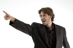 Uomo gridante che indica obliquamente immagine stock