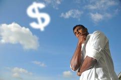 Uomo indiano asiatico che pensa ai soldi Fotografia Stock