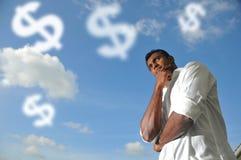 Uomo indiano asiatico che si preoccupa per i soldi Immagine Stock Libera da Diritti