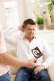 Uomo infelice circa la gravidanza Immagine Stock Libera da Diritti