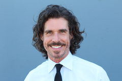 Uomo invecchiato centrale sorridente di affari Fotografia Stock