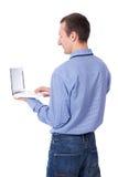 Uomo invecchiato mezzo di affari che per mezzo del computer portatile isolato su bianco Immagine Stock Libera da Diritti