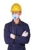 Uomo isolato con i vestiti da lavoro di protezione Immagini Stock Libere da Diritti