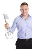 Uomo isolato fiero di affari che tiene una chiave per una nuova casa nel suo Fotografia Stock Libera da Diritti