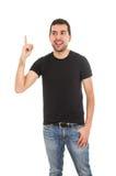 Uomo latino che indica su con il dito Fotografia Stock