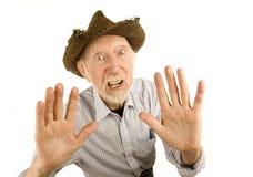 Uomo maggiore in cappello di paglia Fotografia Stock Libera da Diritti