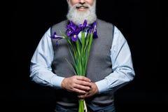 Uomo maggiore con i fiori Immagini Stock