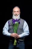 Uomo maggiore con i fiori Fotografia Stock