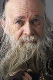 Uomo maggiore con la barba lunga Fotografie Stock