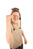 Uomo maggiore in protezione del knit che agita pugno immagine stock libera da diritti