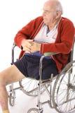 Uomo maggiore in sedia a rotelle Fotografia Stock Libera da Diritti