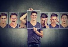 Uomo mascherato che esprime le emozioni differenti immagini stock libere da diritti