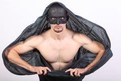 Uomo mascherato con capo Fotografie Stock Libere da Diritti