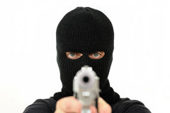 Uomo mascherato con la pistola Fotografia Stock Libera da Diritti