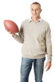 Uomo maturo che tiene una palla di rugby Immagini Stock Libere da Diritti