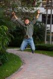Uomo in a mezz'aria che salta per la gioia Immagine Stock Libera da Diritti
