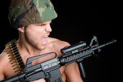 Uomo militare della pistola Fotografia Stock