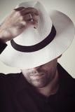 Uomo misterioso in cappello Immagine Stock