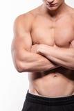 Uomo muscolare con le mani attraversate fotografia stock