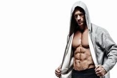 Uomo muscolare su un fondo bianco Immagine Stock