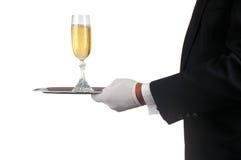 Uomo nel servizio Champagne dello smoking Immagini Stock
