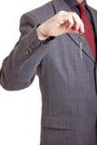Uomo nel tasto della holding del vestito Fotografia Stock