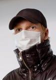 Uomo nella mascherina medica Fotografie Stock