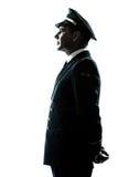Uomo nella siluetta dell'uniforme del pilota di linea aerea Immagine Stock Libera da Diritti