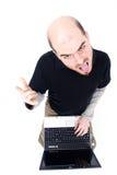 Uomo pazzesco con il computer portatile Fotografia Stock Libera da Diritti