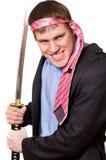 Uomo pazzesco di affari con una spada fotografia stock