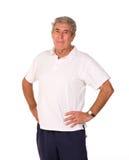 Uomo più anziano maturo che allunga durante il preriscaldamento Immagini Stock Libere da Diritti