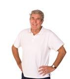 Uomo più anziano maturo che allunga durante il preriscaldamento Fotografia Stock