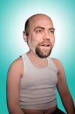 Uomo in piccola maglietta Immagine Stock
