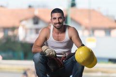 Uomo pigro su costruzione Immagine Stock Libera da Diritti